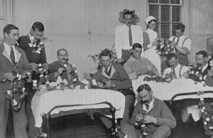 British soldiers making Christmas decorations while recouperating at Fulham Hospital during WWI